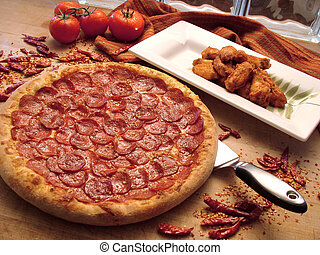 pepperoni pizza with hot wings - large pepperoni pizza with...