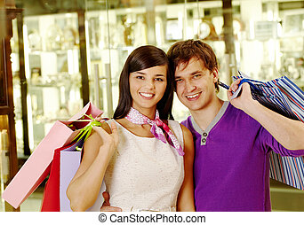 Couple with bags - Portrait of joyful husband and wife after...