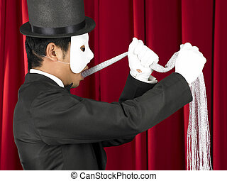 Magician - Escape Artist Performing on Stage