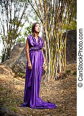 Woman wearing a dress in Roman style