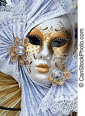 yellow and white venice carnival mask
