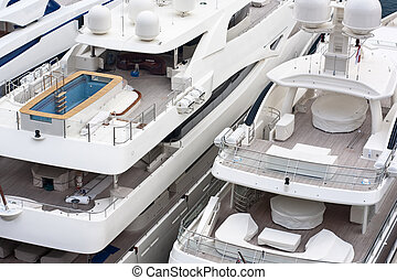 luxurious triple deck yachts in french riviera