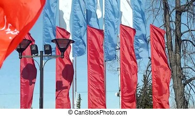 Russian and Soviet flags at Victory Day celebration in...