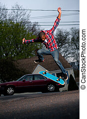 Skateboarder Man Doing a Kick Flip - A skateboarder...