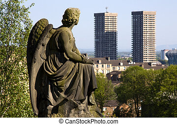 Urban Angel - Urban angel contemplating two high-rise tower...