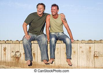 A happy gay couple on beach