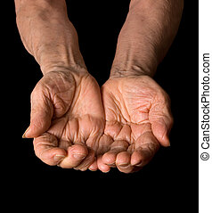 Hands of the old woman on a black background - Hands of old...