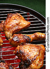 organic roasted chicken parts on a barbecue