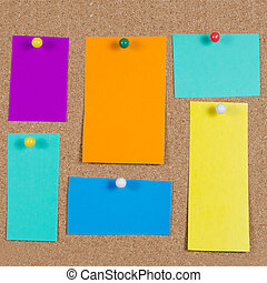 collection of note papers on corkboard - collection of...