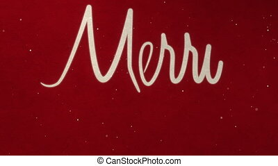 Drawing text MARRY CHRISTMAS on red paper with snow