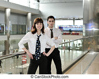 Business people in office environment - young man and woman...