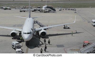 Timelapse Debarking airplane - Passengers debarking an...