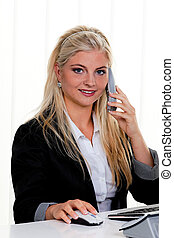 Woman on phone - Young woman on the phone a customer service...