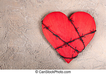 Heart with barbed wire - Barebed wire wound around a red...