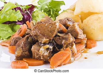 Stewed beef steak with potatoes and salad - Meal of stewed...
