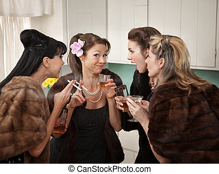 Women Joking and Smoking - Four Caucasian women in mink...