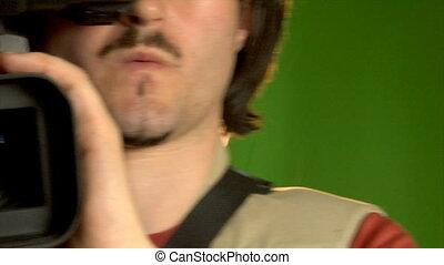 cameraman in studio - close-up cameraman shooting in studio
