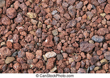 Red gravel in a garden. Stones background