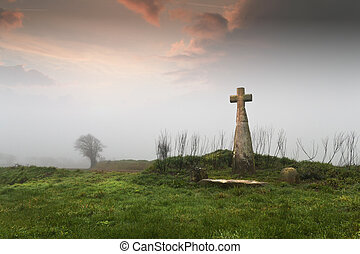Mystery - Crucifix in France, early in the morning on a...