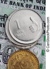 Closeup of Indian Rupee Coins on notes