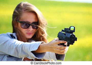 woman with pistol close up portrait
