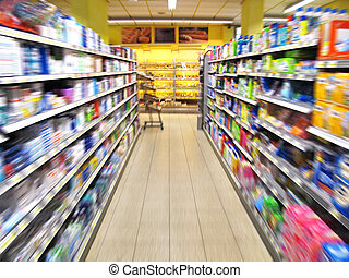 supermarket aisle - aisle of a supermarket with blurred...