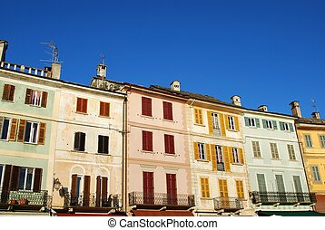 Colorful houses - Typical colorful houses on blue sky, Orta...