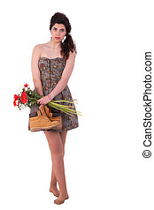 beautiful young woman, with with daisies, gerberas and boots in hand, isolated on white, studio shot