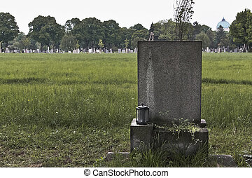 Blank and lonely grave - Blank tombstone on a grave in the...