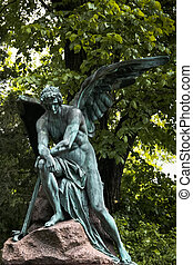 Lonely angel protecting a grave on Vienna's central cemetery