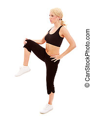 Hamstrings - A young female dressed in black gym clothes...