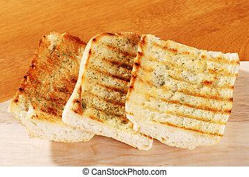 garlic bread with cutting board