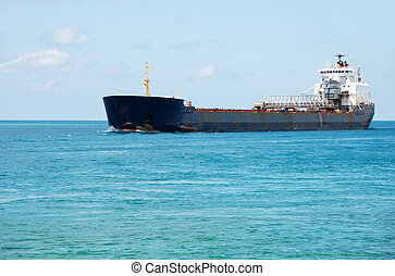 Great Lakes ship with blue sky