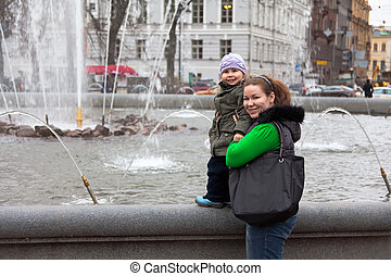 Mother and small child in city