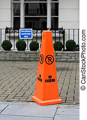 No parking - Florescent orange cone with no parking sign