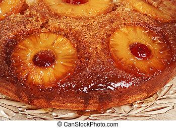 macro pineapple upside down cake on glass platter