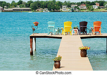 quite dock with colorful chairs