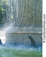 An Outdoor Park Fountain Spraying Water on a Sunny Day