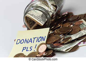 Donation - Collection of coins in a jar labeled for donation...