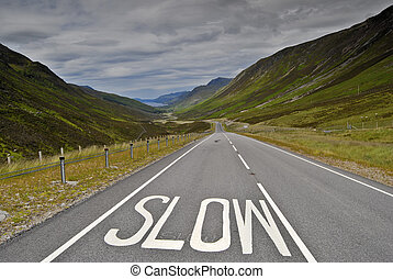 Slow sign on road - Slow sign on the road to Torridon, NW...