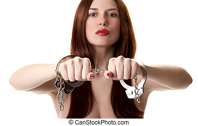 Young saxy brunette in handcuffs