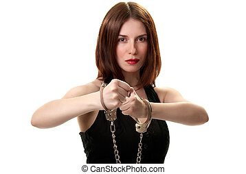 Young saxy brunette in handcuffs isolated on white...