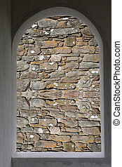 No way out - Window frame with a stone wall