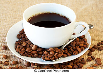 Cup of coffee with coffee beans - Cup of fresh brewed coffee...