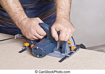 Carpenter with circular saw - Close-up of a construction...