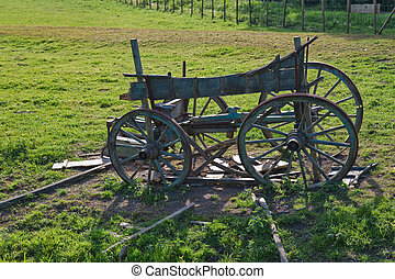 Old wooden horse cart on a field