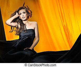 Young attractive woman over yellow background