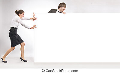 Business people pulling an empty white board, lots of copyspace