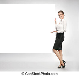 Attractive businesswoman showing empty white board