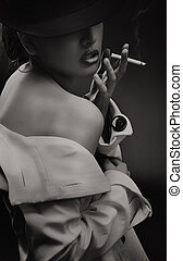 Fine art portrait of a beautiful lady with cigarette - b w...
